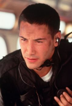 Keanu in Speed. The hottest of all the Keanus. It's the vest. And the hair.