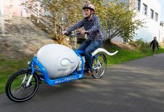 Biological analyst Alan Dowden of the Seattle Sperm Bank rides the Sperm Bike, a custom-designed, high-tech bicycle used to deliver donated sperm to fertility clinics in Seattle