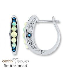 Round natural opals give these hoop earrings from the Earthly Treasures Smithsonian® collection shimmering color, while round Swiss blue topaz above and below add contrast. The profiles of the sterling silver earrings each display a Swiss blue topaz accent to complete the look. The earrings secure with hinged backs. Exclusively available from Jared® the Galleria of Jewelry.