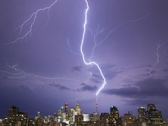 A bolt of lightning strikes the CN Tower, once the tallest free-standing building in the world, in Toronto, Canada.