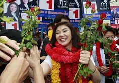Yingluck Shinawatra, Pheu Thai Party's candidate for Prime Minister, greeted by supporters during a campaign rally in Bangkok. File photo