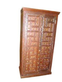 """Huge Old Door Cabinet Antique Patina Teak Wood Armoire India FREE SHIP by Mogul Interior. $1868.00. This beautiful piece is made of teak wood in an antique brown finish with brass accents all over the door.. Our hand carved rustic wood armoire furniture is uniquely designed, which will give you affortable solutions for any room in your home and provide yeas of comfort and enjoyment.. Exterior Dimensions : Height 77"""" x Width 38"""" x Depth 21""""(add 3 inches for crow..."""