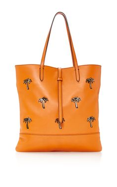 This Tomas Maier shopping bag is rendered in tangerine leather and features dual shoulder straps.