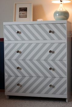 DIY Chevron dresser makeover tutorial from hatzistwins.blogspot.com - I really like the layout of this chevron!