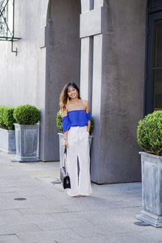 white pants, wide leg pants, trousers, off the shoulder top, its, yellow tassel earrings