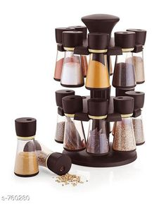 Glassware & Drinkware Spice Rack  Material: Plastic  Dimension: (L x W x H) 10 cm x 10 cm x 20 cm  Description: It Has 16 Pieces Of Revolving Jar With Spice Rack Country of Origin: India Sizes Available: Free Size   Catalog Rating: ★3.9 (375)  Catalog Name: Free Gift Finelure Basic Kitchen Utilities Vol 14 CatalogID_86570 C136-SC1603 Code: 974-760280-