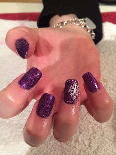 Purple glitter nails with snowflakes