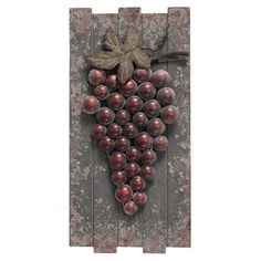 Wood and metal wall decor with a planked design and textural grapes accent.   Product: Wall decor Construction Mate...