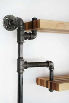 Industrial three level shelving unit with butcher block style assorted wood shelves. Wood is former floorboard samples. Whether you are looking for a piece that stands out in your home, or looking to… Diy Pipe Shelves, Industrial Pipe Shelves, Industrial House, Wood Shelves, Industrial Style, Black Pipe Shelving, Vintage Furniture Design, Industrial Design Furniture, Pipe Furniture
