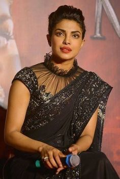 25 Latest Black Saree Blouse Designs - - Black is a color that looks very interesting, classy and one can never go wrong in a black outfit. In fact, black also makes you look slim and hide the flabs. We've compiled the list of the beautif…. Blouse Back Neck Designs, Netted Blouse Designs, Fancy Blouse Designs, Bridal Blouse Designs, Saree Jacket Designs Latest, Black Saree Designs, Indian Blouse Designs, Dress Designs, Bollywood Stars