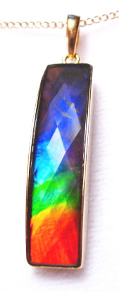 18K Ammolite Bar Column Pendant Necklace Faceted 77GP$699.99#ammolite #korite #ammonite #fengshui #canada #canadagems #canadianammolite #gemstones #jewelry #jewelryaddict #photooftheday #jewelryoftheday #jewelrygram #colorful #gem #gems #opal #minerals #natureinspired #rainbow #alberta #fossil #Alaska #followersofinstagram #isellrocks #art #handmade #lapidary #madeinmontana #pride Heart Pendant Necklace, Necklace Set, Star Of David Pendant, Ammonite, Gold Pendant, Flask, 18k Gold, Pendants, Gemstones