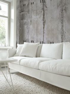 White room perfectly complimented by the RSW Concrete wallpaper.