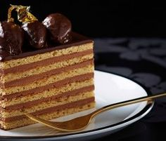 Plaistowe Opera Cake: Spend some time getting the layers just right on this beautiful Opera cake with notes of dark chocolate, vanilla and coffee. http://www.bakers-corner.com.au/recipes/cakes/plaistowe-opera-cake/