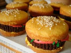 Hamburger Cupcakes. They were made in two batches, one using yellow cake mix, and the other using chocolate cake mix. The different toppings (ketchup, mustard, and lettuce) were made using food coloring and frosting and shredded coconut.