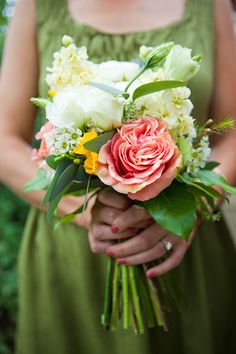 I love the big coral peony as the focal flower. Do you want loose and colorful, or more shapely and monochromatic?