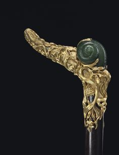 Continental ormolu-mounted nephrite cane made with a handle with a fully sculpted snail amongst naturalistically modeled lush vinery and flowers, late Century