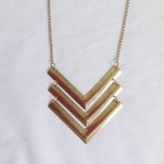 LAST CHANCE | Chevron necklace This item is used. Gold chevron statement necklace. Markings on the gold. Rubbing/fading of gold on chain near latch closure. 🚫no trades or paypal🚫 Wet Seal Jewelry Necklaces