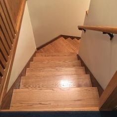 Refaced stairs with oak stair treads #lnk#customwoodworking#classicwood#hardwood#kitchencabinets #entertainmentcenter via ClassicWoodLincoln.com
