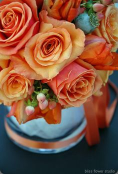 Some like it hot-Orange parrot tuplips, peach hypericum berries, Spicy roses, Milva roses and poppy pods!