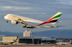 Emirates A380-800 casting some long shadows as she starts her flight home on Jan. 2, 2016.