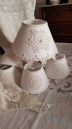 SIMPLY  TAKE A LAMP SHADE AND GLUE A DOILY ONTO IT.