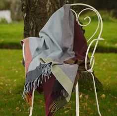 Color: Multi Color. Large decorative 100% lambswool throw. Made in Ireland