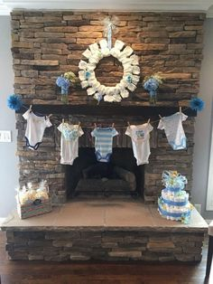 Diaper cake, diaper wreath, and baby clothes on ma… DIY baby shower decorations! Diaper cake, diaper wreath, and baby clothes on mantle/fireplace make for a … Idee Baby Shower, Diaper Shower, Girl Shower, Baby Shower Games, Baby Shower Parties, Boy Baby Showers, Baby Shower Cakes For Boys, Baby Shower Stuff, Baby Shower Favors Boy