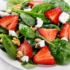 This spinach salad with strawberries recipe is topped with crunchy walnuts, soft feta and a delicious homemade balsamic salad dressing.. Spinach Salad with Strawberries Recipe from Grandmothers Kitchen.