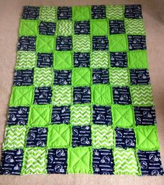 Go Hawks!! Large quilted seattle Seahawks-themed throw . Perfect to snuggle up with during game time