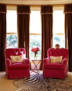 """pink fabric on upholstered chairs (""""Ne Plus Ultra''/Plum, by Decorators Walk): Schumacher, 800/523-1200, fschumacher.com.  Floral pillows on chairs (""""Kashmir''/India #152B26): Raoul Textiles, 805/965-1694, raoultextiles.com.  Colorful & Stylish Family Home - Traditional Home®"""