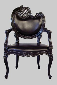 Jimmie Martin Ltd. 2009  Dark sleek look of the chair paired with ornate detailing and flowing curves. I love mixing art and function.