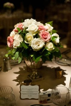 pink and white rose centerpieces, thank you notes at place settings