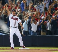 Standing at Third base Chipper Jones reacts with the Braves Fans after Freddie Freeman hits a two-run home  run in the Ninth Inning to beat the Miami Marlins 4-3 to clinch a playoff spot and at least NL wild-card berth.