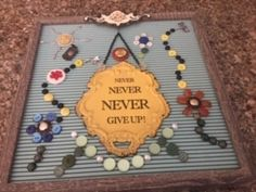Bought this letter board and came up with this idea to decorate it using buttons and some odds and ends of old jewelry.