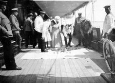 Tsar Nicholas II and Tsarina Alexandra with officers at the Standart.