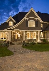 Love the line of the roof, the irregular stone sidewalk, the arched doorway, the dormer window... I could go on & on!