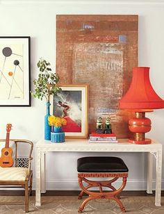 Colorful eclectic style, artwork layering, red lamp, white chinois console table, stool