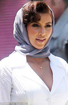 Kim Kardashian dons a headscarf as she rocks and rolls in hot 50s ...