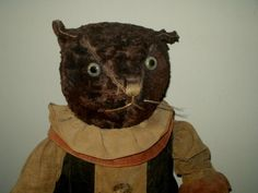 Antique stuffed cat...love love love the floppy ear.