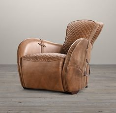 Call me crazy, but this just looks kind of cool and looks like it would fit in with stuff you like. Equestrian Saddle Chair Restoration Hardware, it's onle oh $1865-$2055 lol