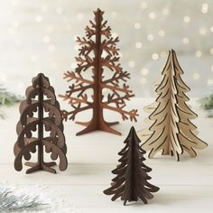Pine boughs unfurl in graceful detail in laser-cut wood.  Pieces assemble to create a modern, dimensional decoration great for table or mantel. PlywoodMade in China.