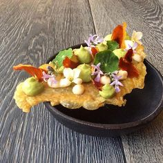 Canapé close up... Chicken skin wafer, Jamon Gran Reserva, whipped avocado…