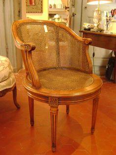 Caned #deskchair with swivel seating #LouisXVI #style in walnut and beechwood. Period late 19th century. For sale on #Proantic by Antiquités Alric.