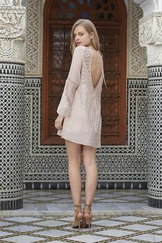 Sequin embellished mini dress with flare sleeves. lace up neckline. open back with tie closure at back. main - 100% polyester lining - 100% rayon - xs length 86 - bust 86 s length 87 - bust 91 m lengt