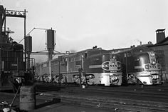 https://flic.kr/p/F3r7N1 | ATSF, Chicago, Illinois, 1946 | Santa Fe Railway passenger diesels—PA no. 51 and FT no. 159—at Chicago's 18th Street terminal on October 26, 1946. Photograph by Wallace W. Abbey, © 2015, Center for Railroad Photography and Art. Abbey-02-072-04