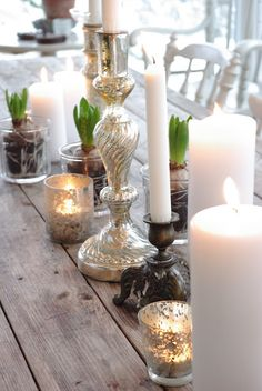 Mercury glass and tulip bulbs with vintage candlesticks.