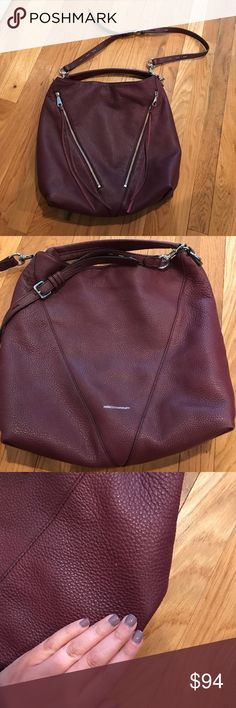 """Rebecca Minkoff Moto Hobo Bag This is a great bag! I carried it for one season. It's very spacious and very stylish. It's a burgundy wine color. See pictures of wear. Just a bit on the bottom corners as photographed and a tiny spot in the front and on the back. I only noticed the flaws when studying to sell. Has a ton of life left! Great for Fall/Winter season. Can be worn as a cross body or shoulder bag. Inside in great condition. It's about 15.5"""" tall and 16.5"""" wide. Comes with extra…"""