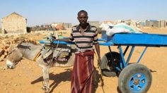 Hassan's steadfast commitment to support his family and his fellow Somalians, even under extremely difficult circumstances, is helping to power his community's recovery from disaster. Photo: Sophia Jones-Mwangi/IRC)