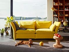 The Vitra Mariposa 2½ Seater Sofa, designed by BarberOsgerby, is modern with a cosy and inviting feel.