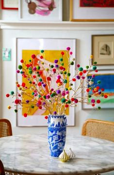 Skip the florals + decorate your table with pom pom branches instead.